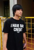 Singapore: Youth in Funny Tee Shirt — Stock Photo