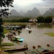 Yangshuo, China: Karst Rock Formations and Lijiang River Boats — Stock Photo #68847775