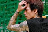 Hong Kong, China: Asian Man with Tattoos — ストック写真