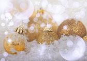 Golden Christmas balls in the snow — Stock Photo