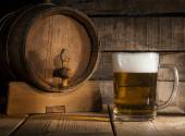 Beer barrel with beer mug on wooden background — Stock Photo