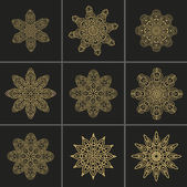 Set of rosettes- snowflakes — Stock Vector