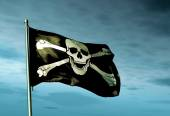 Pirate skull and crossbones flag waving on the wind — Stock Photo
