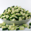 Chopped zucchini in a bowl isolated on white — Stock Photo #58907335
