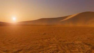Movement through the desert at sunset — Stockvideo