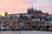 Prague gothic Castle with Charles Bridge after sunset, Czech Republic — Stock Photo