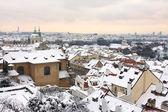 Romantic snowy Prague with St. Nicholas' Cathedral, Czech Republic — Stock fotografie
