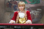 Boy in period costume playing the keyboard — Stock Photo