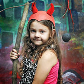 girl in the role of a daemon on Halloween — Stock Photo