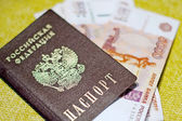 Russian passport, Russian money out of the bank passbook — Stock Photo
