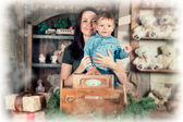 Christmas portrait of a little boy and his mom — Stock Photo