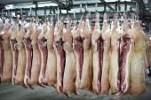 Pork carcasses on hooks — Stock Photo