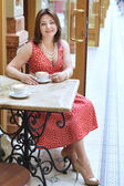 Woman with Cup of coffee in the cafe — Stock Photo