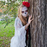The girl in the image of Santa Muerte — Stock Photo #61435607