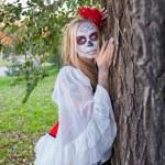 The girl in the image of Santa Muerte — Stock Photo #61435671