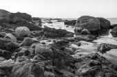 Monochrome photo landscape of sea rocky coast — Stock Photo