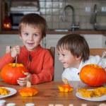 Two adorable boys, preparing jack o lantern for Halloween — Stock Photo #56128141