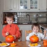 Two adorable boys, preparing jack o lantern for Halloween — Stock Photo #56128143