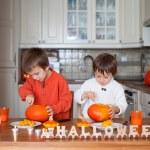 Two adorable boys, preparing jack o lantern for Halloween — Stock Photo #56128145