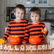 Two boys at home, preparing pumpkins for halloween — Stock Photo #56128149