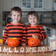 Two boys at home, preparing pumpkins for halloween — Stock Photo #56128161