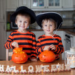 Two boys at home, preparing pumpkins for halloween — Stock Photo #56128219