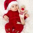 Little cute baby boy, dressed in red overall with santa hat — Stock Photo #56128851