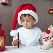 Adorable little boy, writing letter to Santa — Stock Photo #56128951