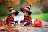 Two boys in the park with Halloween costumes — Stockfoto