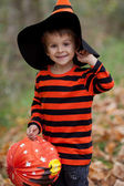 Cute boy in the park, dressed for Halloween — Stock Photo