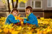 Two boys in the park on sunset — Stock Photo