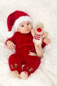 Little cute baby boy, dressed in red overall with santa hat — Stockfoto