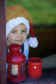 Adorable boy, looking through window, waiting for Santa — Foto Stock