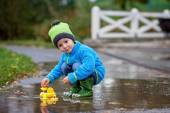 Little boy, jumping in muddy puddles  — Stock Photo