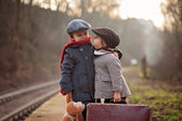Two boys on a railway station, waiting for the train — Foto de Stock