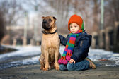 Little boy in the park with his dog friends — Stock Photo