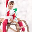 Cute boy on christmas, having fun with snowman — Stock Photo #57772149