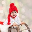 Cute boy on christmas, having fun with snowman — Stock Photo #57772169