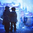 Silhouettes of two kids, standing on a stairs, view of Prague be — Stock Photo #57934161