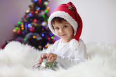 Cute adorable boy enjoying his candy at christmas time — Stock Photo