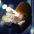 Cute boy, holding lantern outdoor — Stock Photo #59975141
