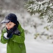 Adorable little boy, blowing snowflakes outside in a snowy day  — Stock Photo #61566949