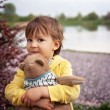 Adorable little boy, holding toy friend in a park — Stock Photo #65597013