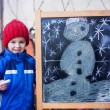 Adorable little boy, drawing winter picture with chalk — Stock Photo #65852091