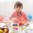 Little boy, coloring eggs for Easter  — Stock Photo #65852111