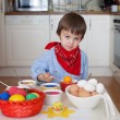 Little boy, coloring eggs for Easter — Stock Photo #65852147