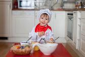 Little boy, coloring eggs for Easter  — Stock fotografie