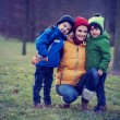 Adorable colorful portrait of a mother with her two boys — Stock Photo #66465113