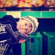 Adorable little boy, sitting in a shopping cart — Stock Photo #66465319
