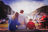 Young family with small kids on a harbor in the afternoon — Stock Photo